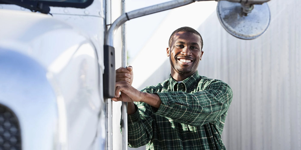 Innovative Learning Solutions Website Image African Truck Training Man Outside Truck